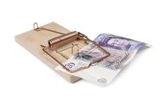 Piège de souris avec l'argent de livre Image stock
