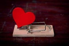 Piège rouge de coeur et de souris Image stock