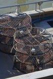 Pièges de crabe sur la plate-forme Photos stock