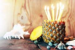 Piña con las velas Fotografía de archivo libre de regalías