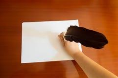 Piórkowy pióra writing Zdjęcia Royalty Free
