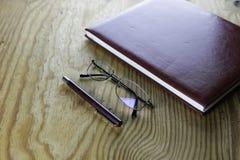 Pióro portfla szkieł biznesowy notatnik zdjęcie royalty free