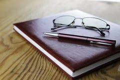 Pióro portfla szkieł biznesowy notatnik obraz stock