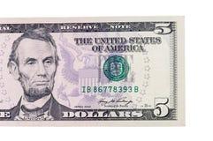 Pięć dolarów banknotów zdjęcia stock