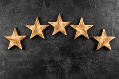 Pięć gwiazd na ciemnym tle Obrazy Stock