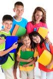 pięć szczęśliwych uczni zdjęcia stock