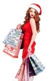 Piękna Śnieżna dziewczyna z barwionymi torbami Zdjęcia Royalty Free
