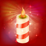 Piękna świąteczna świeczka Czerwony tło z głównymi atrakcjami Puste miejsce dla projekta również zwrócić corel ilustracji wektora Fotografia Stock
