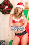 piękna blondynka Claus target1157_0_ kobiety odzieżowy Santa zdjęcia stock