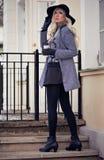 Piękna blondynki dziewczyna z kawą Fotografia Stock