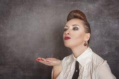 piękna dmuchania buziaka kobieta Fotografia Stock