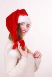 Piękna dziewczyna jest ubranym boże narodzenie nakrętkę Fotografia Royalty Free