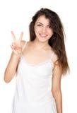 Piękna dziewczyna pokazuje zwycięstwo Zdjęcie Stock