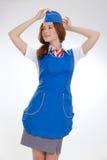 Piękna dziewczyna w błękitnych mundurach obrazy royalty free