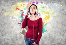 Dziewczyna z słuchawkami Fotografia Royalty Free