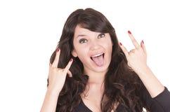 Piękna figlarnie dziewczyna gestykuluje rock and roll Fotografia Royalty Free
