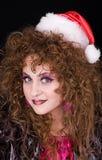 piękna kędzierzawa dziewczyna głowiasty Santa Zdjęcie Royalty Free