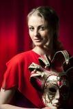 Piękna kobieta chuje karnawałową venetian maskę Obraz Stock