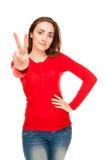 Piękna kobieta pokazywać zwycięstwa znaka lub pokój Zdjęcia Royalty Free