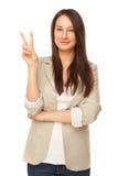Piękna kobieta pokazywać zwycięstwa znaka lub pokój Obraz Royalty Free