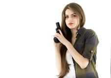 Piękna kobieta trzyma pistolet na białym tle zdjęcie royalty free