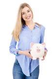 Piękna kobieta trzyma prosiątko banka Obrazy Stock