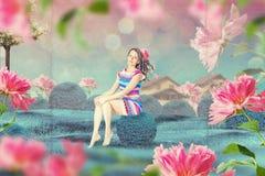 Piękna kobieta w czarodziejka ogródzie w kwiatach royalty ilustracja