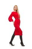 Piękna kobieta w czerwieni długiej sukni odizolowywającej dalej Zdjęcia Stock
