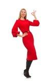 Piękna kobieta w czerwieni długiej sukni odizolowywającej dalej Obrazy Stock