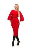 Piękna kobieta w czerwieni długiej sukni odizolowywającej dalej Fotografia Stock