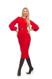 Piękna kobieta w czerwieni długiej sukni odizolowywającej dalej Zdjęcia Royalty Free
