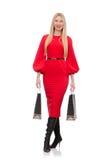 Piękna kobieta w czerwieni długiej sukni odizolowywającej na Fotografia Royalty Free