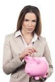 Piękna kobieta z prosiątko bankiem zdjęcie royalty free