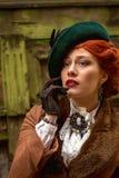 Piękna kobiety twarz w czerwień włosy i kapeluszu obraz stock