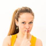 piękna młoda świeża kobieta hushing Fotografia Stock
