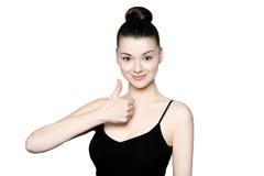 Piękna młoda brunetki kobieta z thum up zdjęcia royalty free