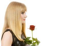 Piękna młoda dama z czerwieni różą Zdjęcia Stock