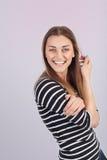 Piękna młoda dziewczyna w pasiastej koszula obraz royalty free