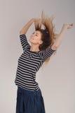 Piękna młoda dziewczyna w pasiastej koszula obrazy royalty free