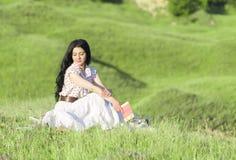 Piękna młoda dziewczyna z książkami Obraz Royalty Free