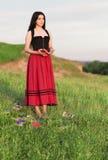 Piękna młoda dziewczyna z książkami Zdjęcie Royalty Free