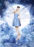 Piękna młoda kobieta jako błękitna czarodziejka Obraz Royalty Free