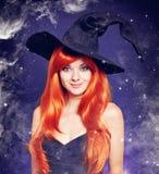 Piękna młoda kobieta jako Halloween czarownica Obraz Stock