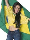 Piękna młoda kobieta jest ubranym piłka nożna wierzchołek obrazy stock