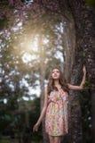 Piękna młoda kobieta myśleć o someone zdjęcia royalty free