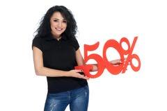 Piękna młoda kobieta trzyma odsetka znaka rabat Zdjęcie Stock