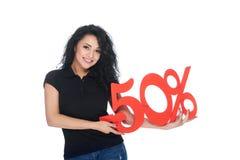 Piękna młoda kobieta trzyma odsetka znaka rabat Obrazy Stock