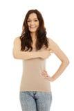 Piękna młoda kobieta wskazuje gdzieś Zdjęcia Stock