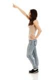 Piękna młoda kobieta wskazuje up Zdjęcia Stock