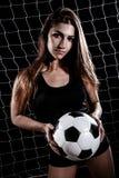 Piękna młoda kobieta z futbolem Obraz Stock